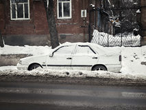 Car in the snow on the roadside Royalty Free Stock Photo