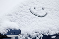 Car with snow and smiley Stock Images