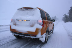 Car with snow on winter road Stock Photo