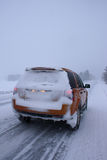 Car with snow on winter road Royalty Free Stock Images