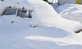 Car in snowbank Stock Photos