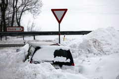 Car in snowbank. After winterstorm. Stock Images
