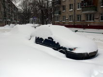 Car in snowdrift after snowfall Royalty Free Stock Photography