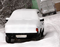 Car after snowfall in city. Stock Image