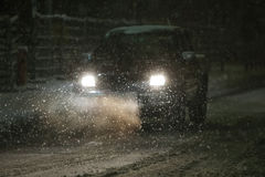 Car in snowfall. Pick up truck driving on the road in the aggravated traffic due to strong snowfall Stock Photography