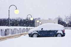 Car during a snowfall in town Royalty Free Stock Images