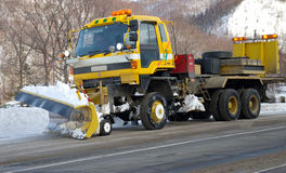 Car-snowplow. Royalty Free Stock Images