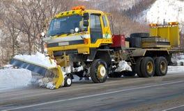 Car-snowplow. Royalty Free Stock Images