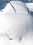 Car After SnowStorm. A front view of a car with its wiper blades standing out after a snow storm has hit Stock Images