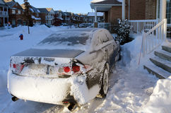 Car after snowstorm. In Canadian town Royalty Free Stock Image