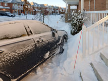 Car after snowstorm. In Canadian town Stock Photos