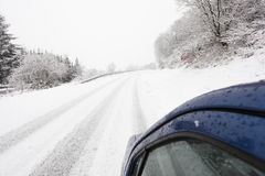 Car on a snowy country road Stock Photos
