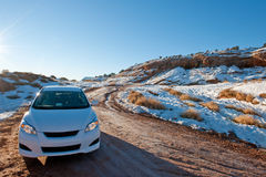 Car in snowy desert Stock Photos