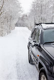 Car on a snowy forest road Royalty Free Stock Photography