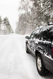 Car on a snowy forest road. In winter Royalty Free Stock Images