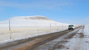 Car on snowy road Stock Photo