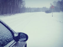 Car on a snowy road Stock Image