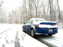 Car on Snowy Road. Sports car stopped on a snowy white winter road in Ohio Stock Images