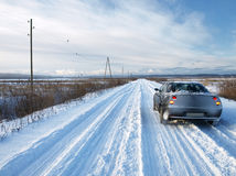 Car on a snowy road Royalty Free Stock Images