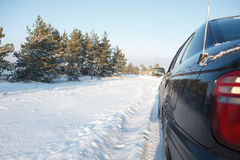 Car on a snowy road Royalty Free Stock Photo