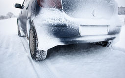 Car on snowy road Royalty Free Stock Image