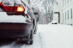 Car on snowy road, winter scene Stock Photo