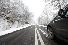 Car on snowy winter road stock images