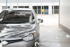 Car soaped at a car wash. Car covered in soap at a car wash Stock Photo