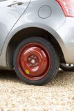 Car with spare tyre fitted. Small car fitted with a spare tyre or tire on a space saver wheel stock photos