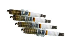 Car spark plugs that have been used for more than 10,000 kilometers isolated on white. Background with clipping path stock image