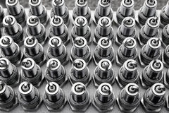 Car spark plugs rows pattern engine pieces Royalty Free Stock Image