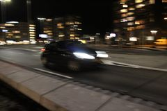 Modern landmark with Car speading freeway blurred motion. Car speading freeway blurred motion at the background building citylights in the night Royalty Free Stock Photography