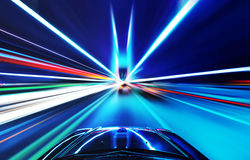 The car sped on the road at night. High-speed car in the bridge, Motion Blur royalty free stock image