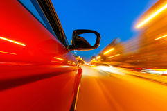 The car sped on the road at night Stock Photos