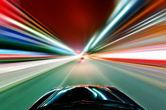 The car sped on the road at night Stock Photo