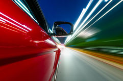 The car sped on the road at night Stock Images