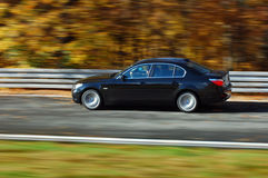Car at speed. BMW at fast ride in the autumn Royalty Free Stock Photography