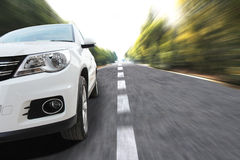 Car at speed. Sports car at speed in country lane stock images