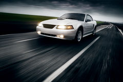 Car Speed Drive fast on the road  at cloudy sky ford mustang Stock Photography