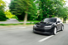 Fast drive black car speed on the road green trees subaru impreza Stock Photos