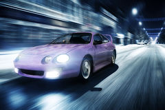 Fast drive car speed on the road at night city toyota celica Royalty Free Stock Photography