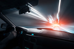 Car speed night drive on the road in city Royalty Free Stock Photo