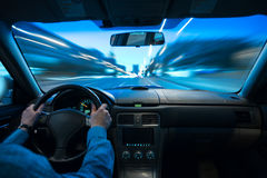 Car speed night drive on the road in city Royalty Free Stock Photos