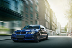 Fast drive blue bmw car speed on the road Royalty Free Stock Image