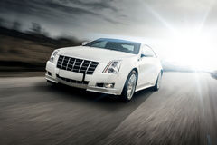 Fast drive car speed on the road sun at summertime cadillac stock images