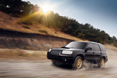 Fast drive car speed on off-road subaru forester at daytime summer dusty Stock Photo