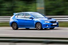 Subaru Impreza speeding on empty highway Royalty Free Stock Photos