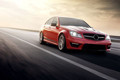 Fast drive red sport car speed on the road mercedes-benz. Sport car speed drive fast on road merdedes benz c63 amg 507 Royalty Free Stock Image