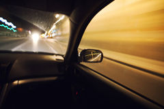Car speeding at night Royalty Free Stock Photo
