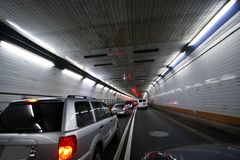 Car speeding and turning tunnel Stock Photo